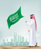 Saudi Arabia Man Holding Flag in the City Royalty Free Stock Images