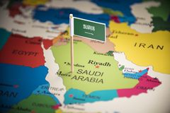 Saudi Arabia marked with a flag on the map.  royalty free stock photography