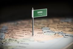 Saudi Arabia marked with a flag on the map.  royalty free stock image