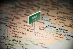 Saudi Arabia marked with a flag on the map.  royalty free stock photo