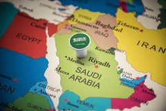 Saudi Arabia marked with a flag on the map.  stock images