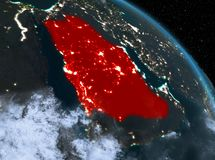 Saudi Arabia at night from orbit. Night above Saudi Arabia highlighted in red on model of planet Earth in space. 3D illustration. Elements of this image Royalty Free Stock Photos