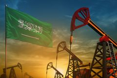 Saudi Arabia oil industry concept. Industrial illustration - Saudi Arabia flag and oil wells against the blue and yellow sunset sk. Saudi Arabia oil industry stock illustration