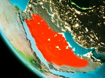 Saudi Arabia in red in the evening. Country of Saudi Arabia in red on planet Earth in the evening. 3D illustration. Elements of this image furnished by NASA Royalty Free Stock Photos