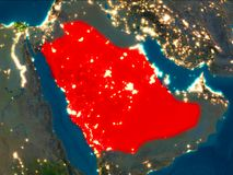 Saudi Arabia in red at night. Satellite night view of Saudi Arabia highlighted in red on planet Earth. 3D illustration. Elements of this image furnished by NASA Stock Photos