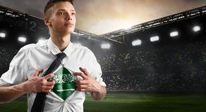 Saudi Arabia soccer or football supporter showing flag royalty free stock photos