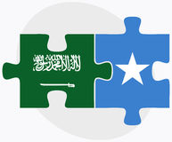 Saudi Arabia and Somalia Flags in puzzle isolated on white background Royalty Free Stock Images