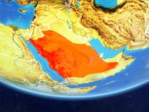 Saudi Arabia from space on Earth. Saudi Arabia on realistic model of planet Earth with country borders and very detailed planet surface and clouds. 3D royalty free illustration
