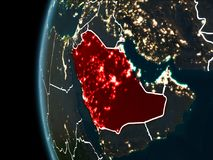 Saudi Arabia from space at night. Orbit view of Saudi Arabia highlighted in red with visible borderlines and city lights on planet Earth at night. 3D Stock Images