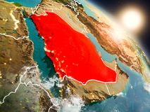 Saudi Arabia from space during sunrise. Sunset above Saudi Arabia from space on planet Earth with visible country borders. 3D illustration. Elements of this Royalty Free Stock Photo