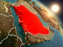 Saudi Arabia from space during sunrise. Sunset above Saudi Arabia from space on planet Earth with visible country borders. 3D illustration. Elements of this Royalty Free Stock Image