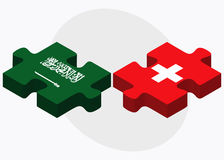 Saudi Arabia and Switzerland Flags in puzzle isolated on white background Royalty Free Stock Photos