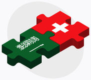 Saudi Arabia and Switzerland Flags in puzzle isolated on white background Royalty Free Stock Image