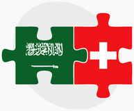 Saudi Arabia and Switzerland Flags in puzzle isolated on white background Royalty Free Stock Images