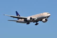 Saudi Arabian Airlines Boeing 777. STERLING, VA, USA - NOVEMBER 9, 2011: Saudi Arabian Airlines Boeing 777 lands at Dulles International Airport. Saudi Arabian Royalty Free Stock Image