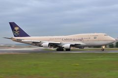 Saudi Arabian B747F. Saudi Arabian Airlines is the flag carrier airline of Saudi Arabia, based in Jeddah and currently the third largest of the region, behind Royalty Free Stock Photography