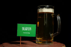 Saudi Arabian flag with beer mug  on black Royalty Free Stock Images