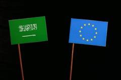 Saudi Arabian flag with European Union EU flag  on black Stock Images