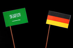 Saudi Arabian flag with German flag  on black Royalty Free Stock Images