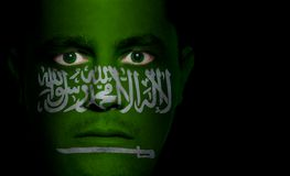 Saudi Arabian Flag - Male Face. Saudi Arabian flag painted/projected onto a man's face royalty free stock photo