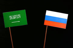 Saudi Arabian flag with Russian flag  on black Stock Photos