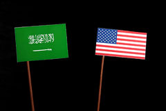 Saudi Arabian flag with USA flag  on black Stock Photography
