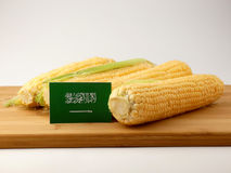 Saudi Arabian flag on a wooden panel with corn isolated on a whi Stock Photos
