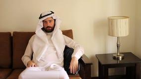 Saudi arabian man at home stock footage