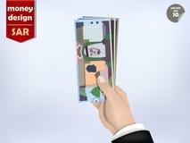 Saudi arabian riyal money paper on hand, Saudi arabian money cash on hand Stock Photography