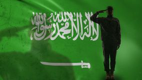 Saudi Arabian soldier silhouette saluting against national flag, country pride. Stock footage stock video