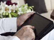 Saudi Arabian VIP Hands Holding Tablet royalty free stock photography