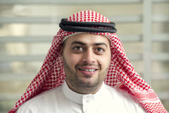 Saudi Arabian young businessman standing in the office Royalty Free Stock Photography
