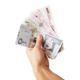 Saudi-Arabien Geld, Banknoten in der Hand lokalisiert auf Weiß lizenzfreie stockbilder