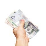 Saudi-Arabien Geld Banknoten in der Hand lokalisiert auf Weiß stockbilder