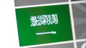 Saudi-Arabien Staatsflagge des Landes Saudi-Arabien Flagge auf der Anzeige, ein digitaler Wässerungseffekt stockfotos