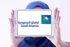 Saudi aramco logo. Logo of Saudi aramco energy and petrochemical company on samsung tablet holded by arab muslim woman Stock Photography