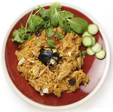 Saudi chicken kabsa meal from above. An authentic Saudi chicken kabsa (known in Qatar as majbous), garnished with raisins and toasted almond flakes, on a serving Royalty Free Stock Photography