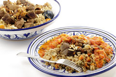Saudi kabsa meal with fork. A traditional Saudi Arabian or Gulf Arab meat kabsa meal, of rice, onion, carrots, capsicum, spices, and beef, served with a homemade Stock Images