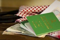 Saudi Travller Document Passport Flight Ticket Saudi Riyals Mone. Y and American Dollars Still Life with Shumagh Head Cover Royalty Free Stock Photos