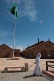 Saudian walking away with Saudian Flag, Saudi Arabia Royalty Free Stock Photography