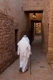 Saudian walking inside the walls of Al-Ula Old City, Saudi Arabi Stock Image