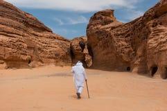 Saudian walking in Madaîn Saleh archeological site, Saudi Arabi Stock Image