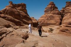 Saudian walking on top of rock formations, Saudi Arabia Royalty Free Stock Photography