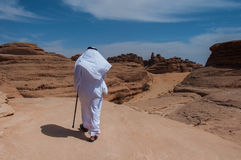 Saudian walking on top of rock formations, Saudi Arabia Royalty Free Stock Photo