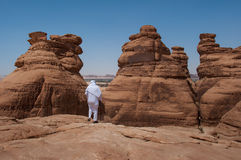 Saudian walking on top of rock formations, Saudi Arabia Royalty Free Stock Photos