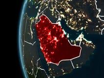 Saudiarabien från utrymme på natten Arkivbilder