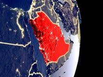 Saudiarabien på nattjord royaltyfri bild