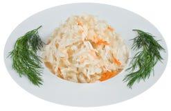 Sauerkraut στο άσπρο πιάτο Στοκ Φωτογραφία