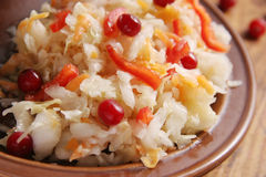 Sauerkraut. Cabbage with pepper and cranberries Stock Photo