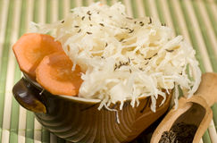 Sauerkraut. With cumin and carrot in brown bowl Stock Image